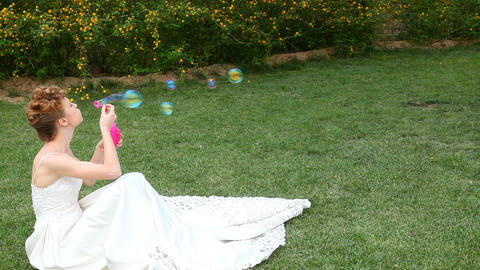 caucasian bride blowing bubbles Footage