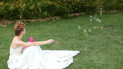 caucasian bride blowing bubbles Stock Video Footage