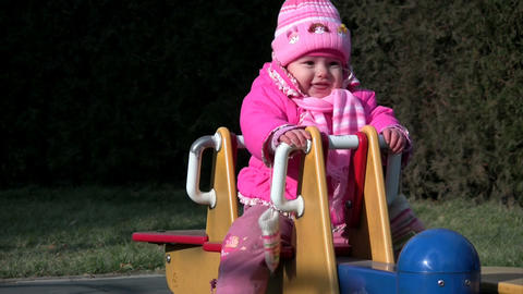 baby on the see saw Stock Video Footage