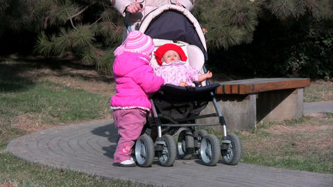 baby with toy doll in pram Stock Video Footage