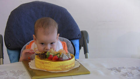 baby boy eating cake Footage