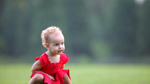 Baby in red dress Footage