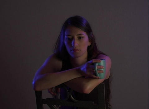 Beautiful Young Brunette Sitting Alone (3) Stock Video Footage