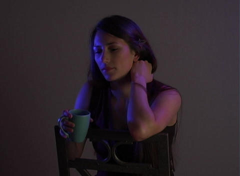 Beautiful Young Brunette Sitting Alone (5) Stock Video Footage