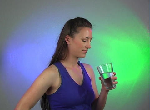 Beautiful Young Brunette Drinking Water (2) Stock Video Footage