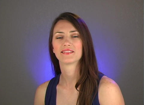 """Beautiful Young Brunette Shakes Her Head """"Yes"""" Stock Video Footage"""