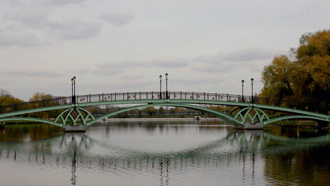Bridge over water in park with mirror ビデオ