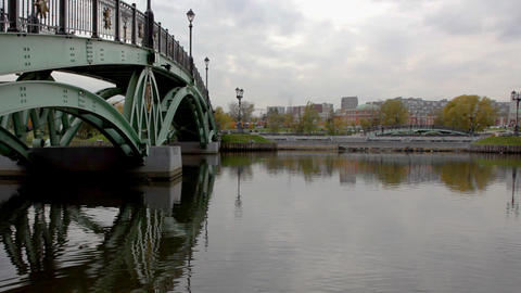 Bridge over water in park with mirror Footage