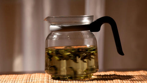 Green Tea Brew In Glass Teapot stock footage