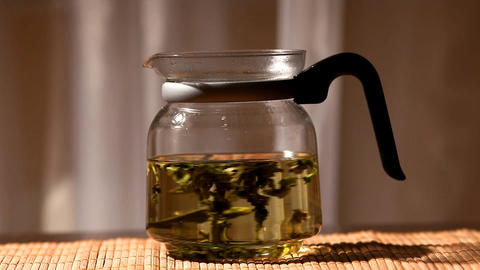 green tea brew in glass teapot Stock Video Footage
