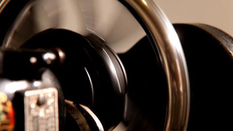 Pan on wheel of stitching machine Stock Video Footage