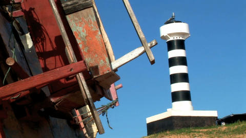 Lighthouse and Old Boat Stock Video Footage