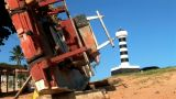 Lighthouse And Old Boat stock footage