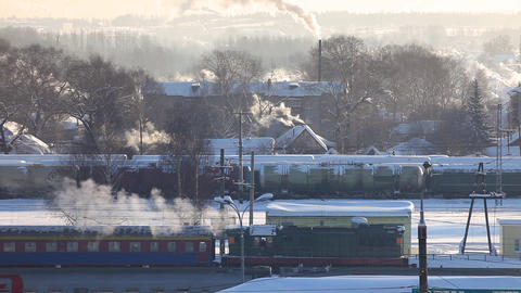 Train departure from winter rail station Stock Video Footage