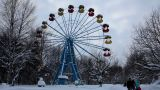 Carousel In Winter Park And Road With People stock footage