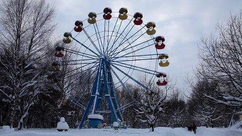 carousel in winter park and road with people Stock Video Footage