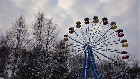 pan from carousel to sky in winter park Stock Video Footage