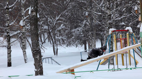 boy up on slide and down winter Stock Video Footage