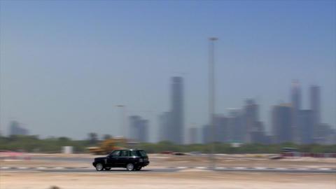 black jeep crossing dubai skyline Stock Video Footage