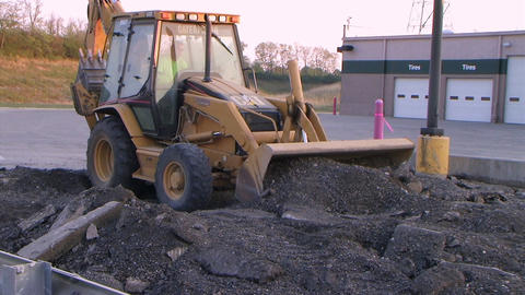 Backhoe Loader Pushing Pavement Stock Video Footage