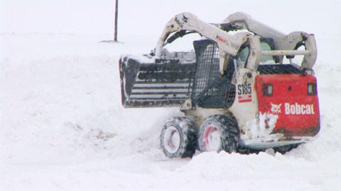 Bobcat Plowing Snow Stock Video Footage