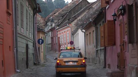 Narrow road in Sighisoara Transylvania Romania Footage