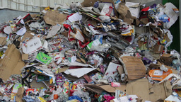 Unsorted wastepaper at recycling center Live Action