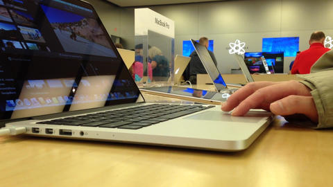 Macro woman browsing website in Apple store on Coq Live Action
