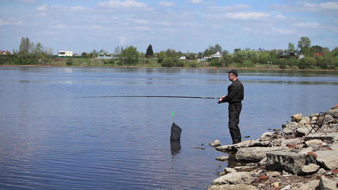 Fishing From The Shore stock footage