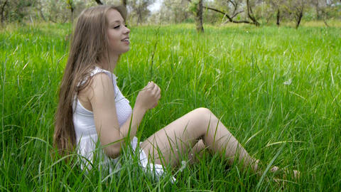 Girls in white resting in the grass Footage