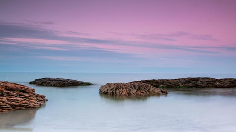 Sea and Stones after Sunset. Timelapse. 4K Footage