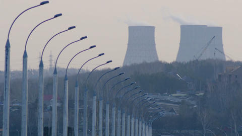 Lamposts And Cooling Towers stock footage