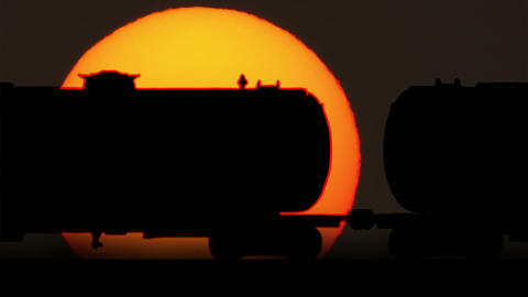 Freight Train Oil Tankers Cars Against Sunrise Footage