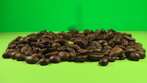 Coffee Beans Falling Into A Pile Of Coffee Beans O Live Action