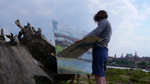 Woman paints a picture outdoors Footage