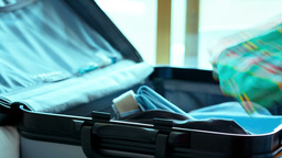 Male Hands Folding Clothes In Travel Bag stock footage