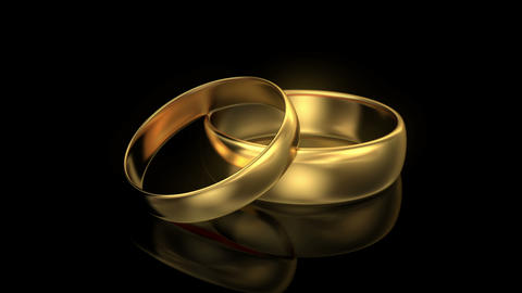 4K Zoom in wedding rings on black background Animation