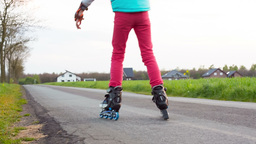 Happy young girl riding on roller blades Footage