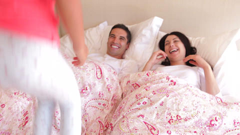 Parents sleeping peacefully in bed before daughter Footage
