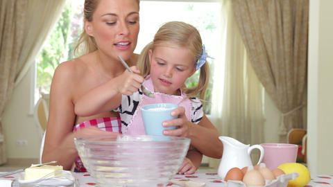 Mother And Daughter Sitting At Kitchen Table Addin stock footage