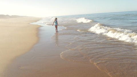 Young Girl Playing In Sea As Waves Break Footage