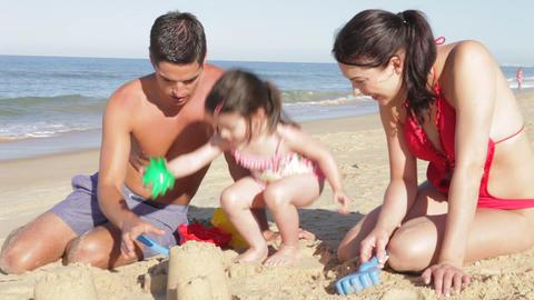 Family Building Sandcastle On Beach Footage