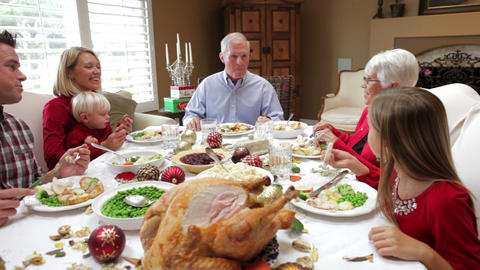 Multi Generation Family Enjoying Thanksgiving Meal stock footage