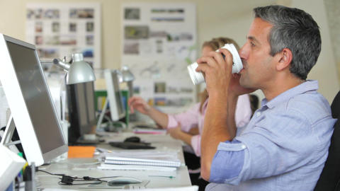 Man At Desk With Mobile Phone Drinking Coffee Footage