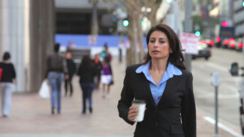Businesswoman In Street Holding Takeaway Coffee Footage