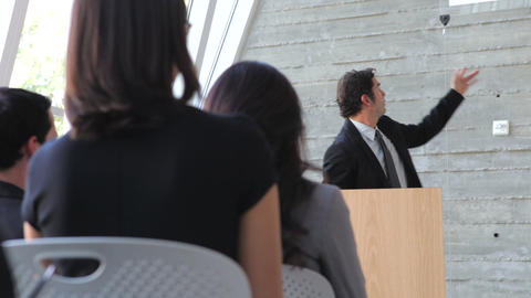 Businessman Giving Presentation At Conference Footage