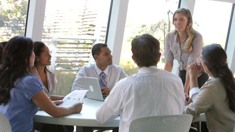 Businesspeople Seated Around Table Having Meeting stock footage