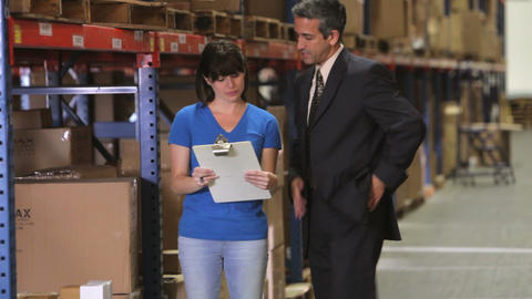 Manager And Worker Checking Goods In Warehouse Footage