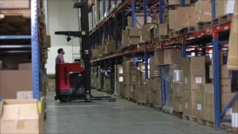 Time Lapse Sequence Fork Lift In Warehouse stock footage