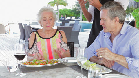 Waiter Serving Pizza To Senior Couple In Outdoor R Footage